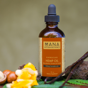 A bottle of Mana Artisan Botanics Hemp Oil surrounded by its ingredients in front of a tan background